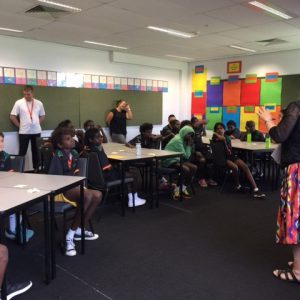 MITS – Head of School, Kathryn Gale, with students in the classroom